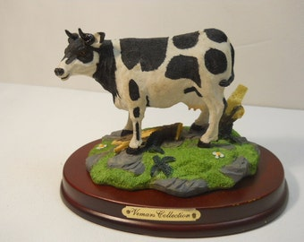 Cow Figurine Standing on grass on a Wood Base #631