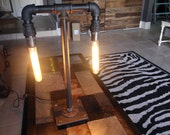 Black pipe table lamp with Amber tube bulbs.