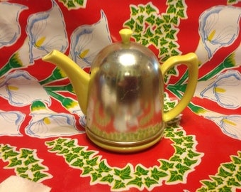 Vintage Hall Pottery yellow teapot with metal insulated cover