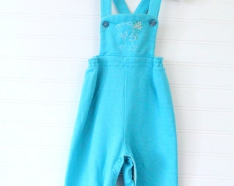 Vintage baby boy overalls. Blue overalls with a bear holding flowers on the chest. Carters sz 24 mo