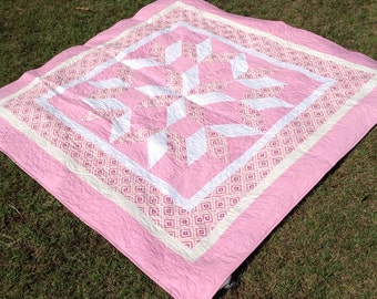 Carpenter's Star Quilt in pink and white. Queen bed size quilt. Home decor