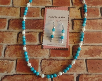 Blue and white glass beaded necklace and earring set