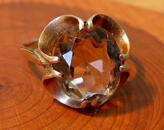 A vintage 9K yellow gold smoky quartz ring