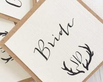 Wedding place card - rustic ivory with antler emblem