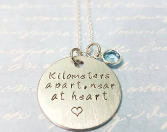 Kilometers apart near at heart hand stamped necklace