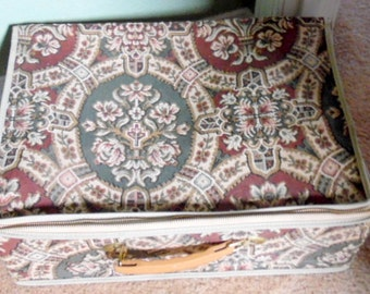 1960-70s style, tapestry suitcase.  Zippered.  Good used condition.  Slight blemish along the piping on edges.