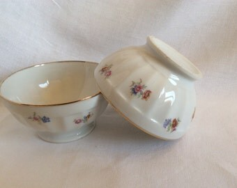 2 white and folded floral patterned breakfast bowls