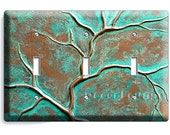 Old worn out copper bronze green patina retro rustic art decor triple light switch wall plate cover living dining room bedroom decoration