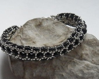 Black and silver woven bracelet BRA135A