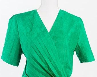 Vintage 1980s green short-sleeved jacket (Size 10 Aust/ 6 USA/ 10 UK)