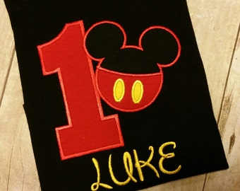 Mickey Mouse pants birthday Number in Red on a Black T-shirt. Numbers are 1-9. Inspired by Disney.