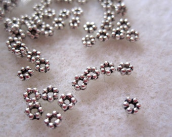 100 - Antique 4 mm Daisy Spacers