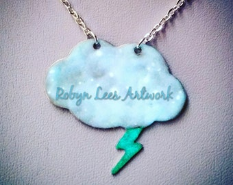 White & Blue Glow in the Dark Cloud and Lightning Bolt Necklace on Silver Crossed Chain