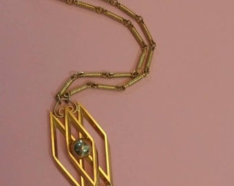 Vintage art deco gold tone pendant necklace.