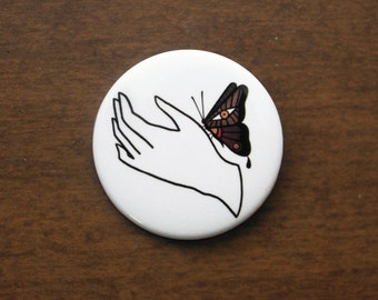 "Hand and Moth 1.5"" Pin"