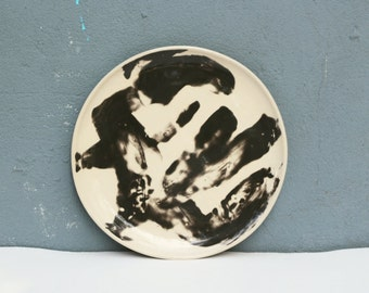 Ceramic serving plate of creme and black stoneware set of two
