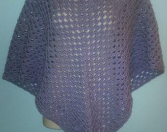 Crocheted triangular shawl in light purple