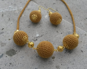 Golden crochet jewelry set of necklace and earrings