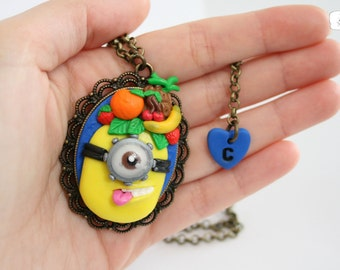 Minion cameo necklace with fruit.