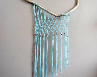 Wall hanging decor with driftood and turquoise wool