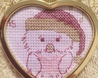 A hoot!- pink and gold cross-stitch