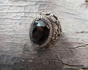 Silver Black stone Ring made from 13.0 gram 925 carat sterling silver. Used Zircon Stones on ring.