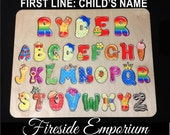 Wooden Childs Name Puzzle with Whimsical Alphabet and Engraved Back