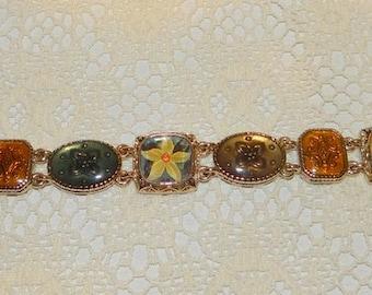 Liz Claiborne Gold Tone Flower Themed Panel Link Bracelet