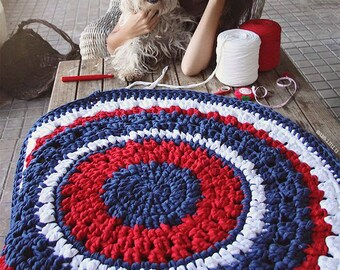 Crochet round rug with openwork in red, dark blue and white. 90 cm in diameter.