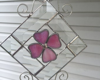 Beveled sun catcher, 6 bevels, with a pink stained glass flower. Wire scrolls.