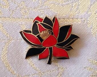 Black and red enamel flower brooch