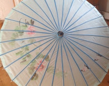 Vintage - umbrella with floral petals on fabric