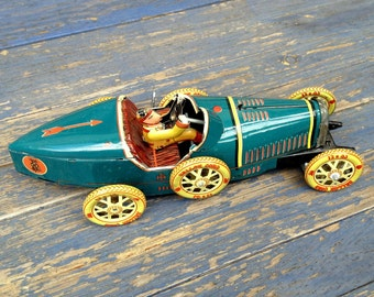 Vintage Bugatti-Sallor Cord tin racing car toy