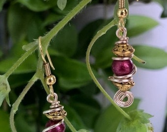 Red glass accent bead swirled with silver & gold