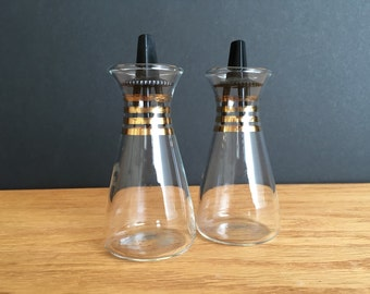 Vintage Pyrex Salt and Pepper Shakers, Clear glass, Plastic tops, Gold trim, Carafe Look
