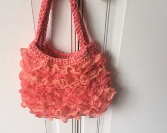 Hand knitted peach handbag