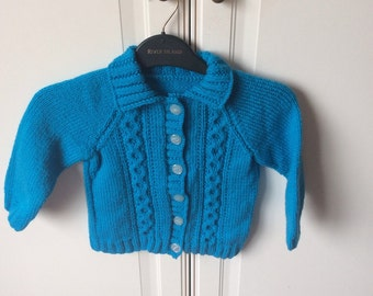 Hand knitted childs turqoise cardigan