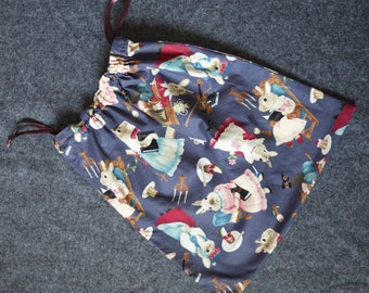 Pouch with fairy tale print rabbits on blue