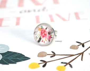 Ring cabochon poetic flowers and feathers
