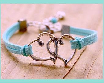 silver hearts bracelet and cord/alcantara. gift idea. love. love. couple.