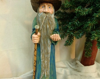 Hand carved wood wizard holding a crystal ball and staff in blue robe by Dan and Debbie Easley