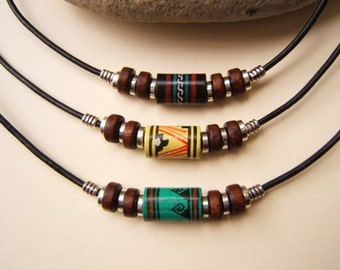 Peruvian ceramic bead necklace. Hand painted Fair Trade. Choice of black, yellow or green bead 2mm black leather cord.