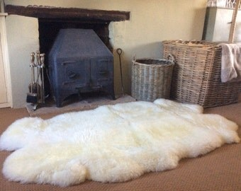 Sheepskin Bed Floor or Sofa Throw Rug Quad with a Dorset story