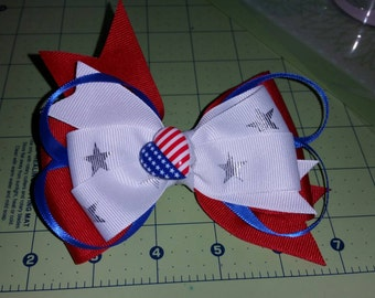 The red, white, and blue bow.