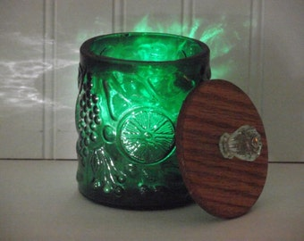 "A former 7"" refrigerator storage jar, cut to a 4"" height & a customized 2 piece oaken lid with a light green glass knob."