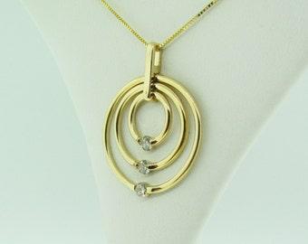 14 K Gold and Diamond Circles Pendant