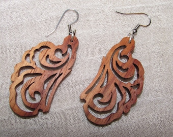 Hand-crafted natural wood earrings. USA made. Unique and one-of-a-kind. Handmade, not laser cut. By GoldfalconWorks.