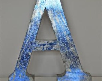 A large 14 inch 3 dimensional blue metal letter A