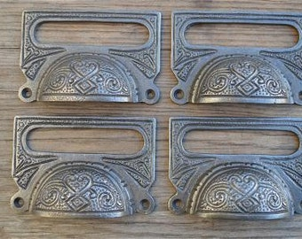 A set of 4 large Edwardian cast iron label frame handles fining cabinet pull CB10