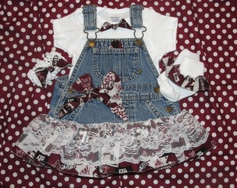 Lacey Baby Aggie!  Cute as a button in this overall dress with skirt trimed in lace. aggie baby, aggie toddler,aggie girl outfit, aggie tutu